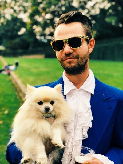 Sunglasses Dog Pets Real People One Person Lifestyles Outdoors Fashion Smiling Portrait Domestic Animals One Animal Young Adult Day Men Mammal One Man Only Adult People First Eyeem Photo