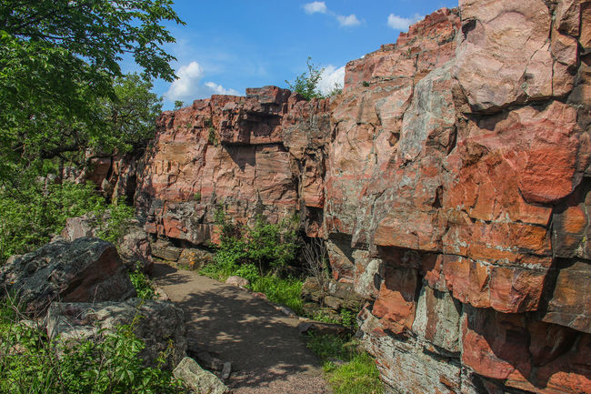Rocky ledge Blue Sky Canon60d Canonphotography EyeEm Gallery Green Nature Outdoors Path Pipestone Pipestone National Monument Plant Rock Rock Formation Rock Outcrop Sioux Quartzite Sky Stone Summer Trail Tree