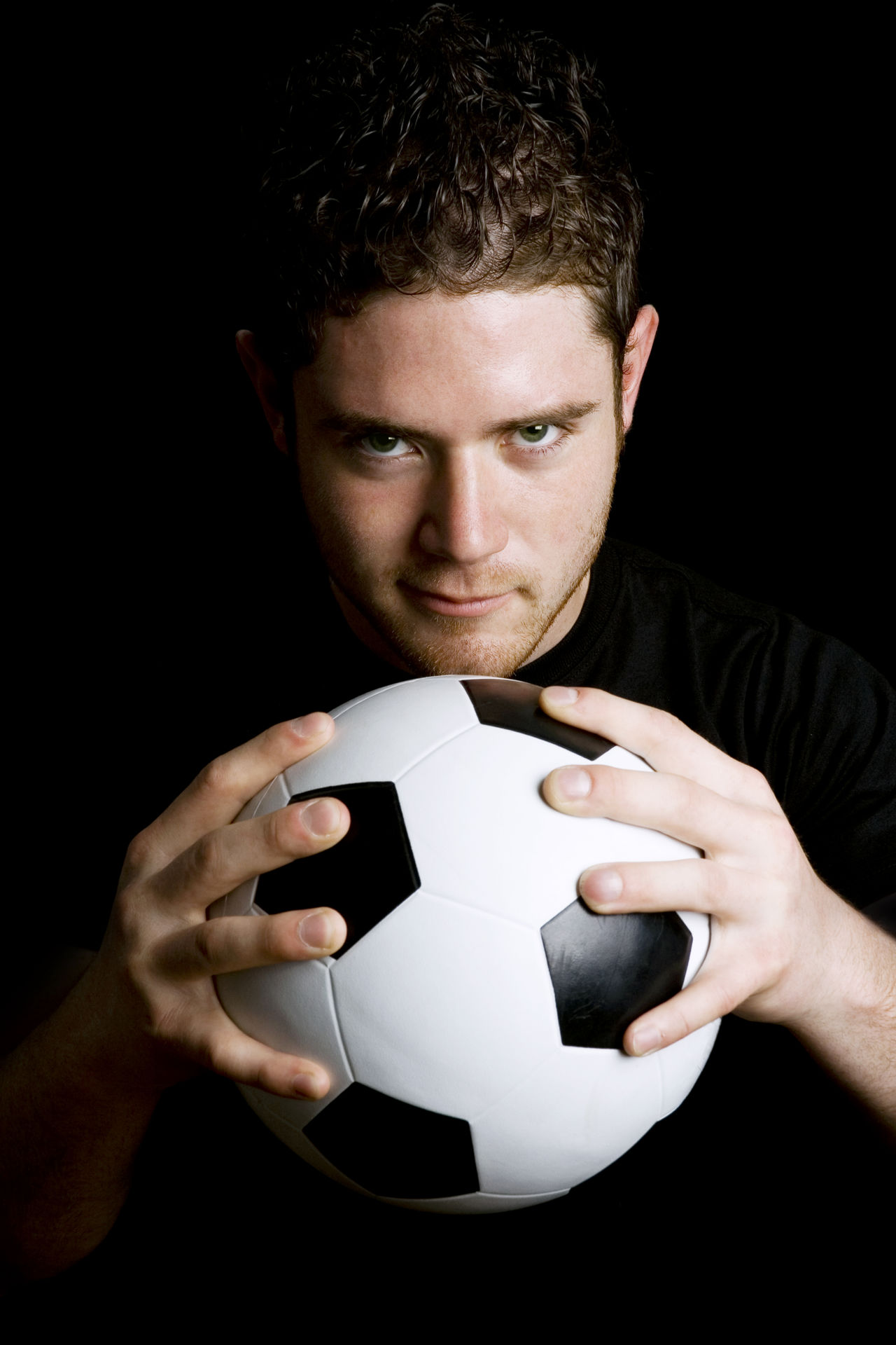 Soccer player Athlete Ball Black Background Caucasian Competition Football Holding Looking At Camera Male Man One Man Only One Person One Young Man Only Only Men People Portrait Soccer Sport Sportsman Studio Shot Vertical Young Adult