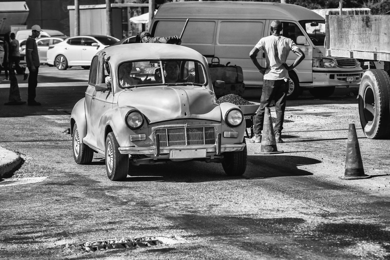 Black And White Car Chance Encounters City Life Classic Car Cuba Collection Cuban Cars Embrace Urban Life Getting Inspired Land Vehicle Mode Of Transport Old Old Car Old Havana Outdoors Streetphotography Transportation Workers