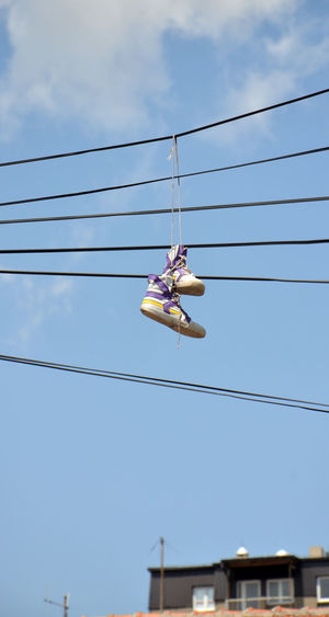sneakers on an electric cable Cable Cables Electric Hang Hanging Happy Sky Sneakers Sport Summer Symbol Youth Culture Youth Of Today