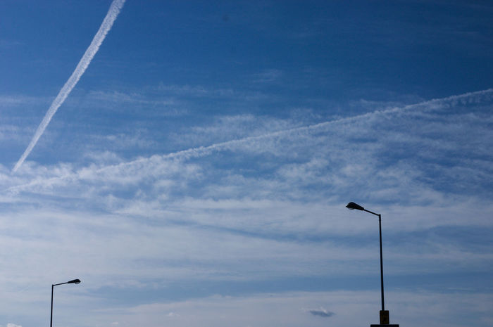 Contrail Day Energy Lighting Equipment Low Angle View Nature No People Outdoors Sky Vapor Trail