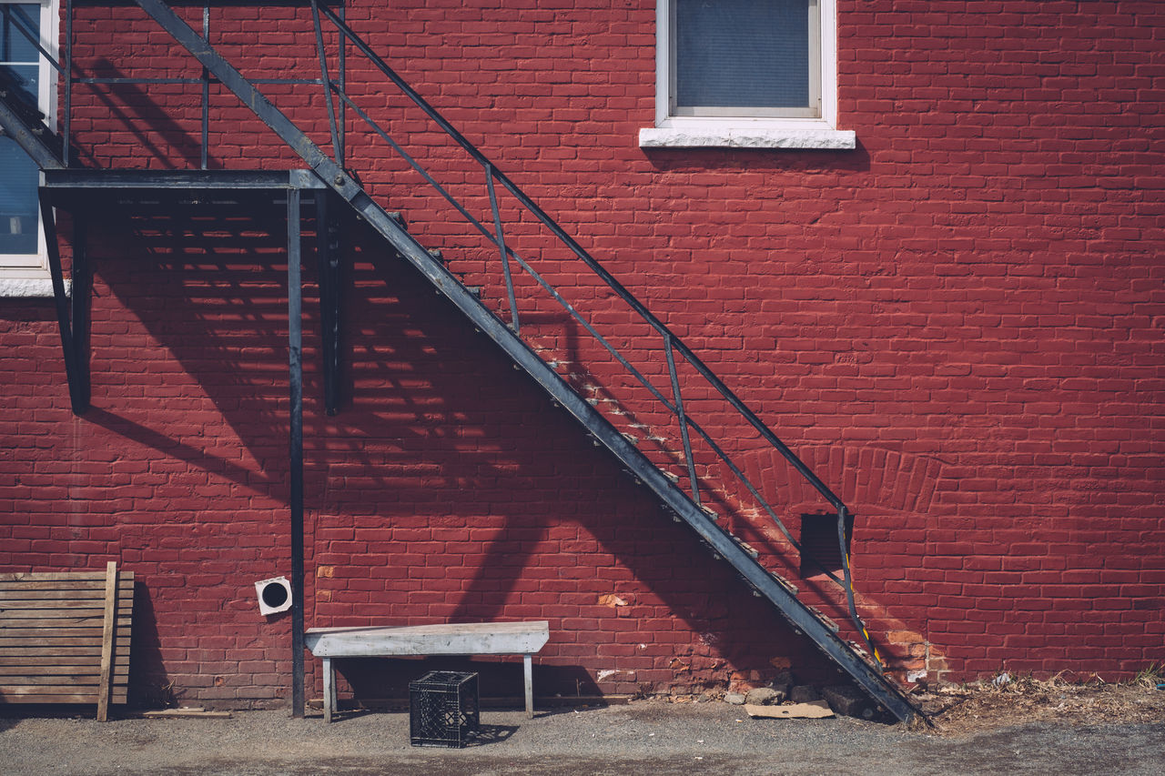 Architecture Bench Brick Wall Building Exterior Built Structure Day Fire Escape No People Outdoors Red Shadow Side Of Building Stair Well Staircase