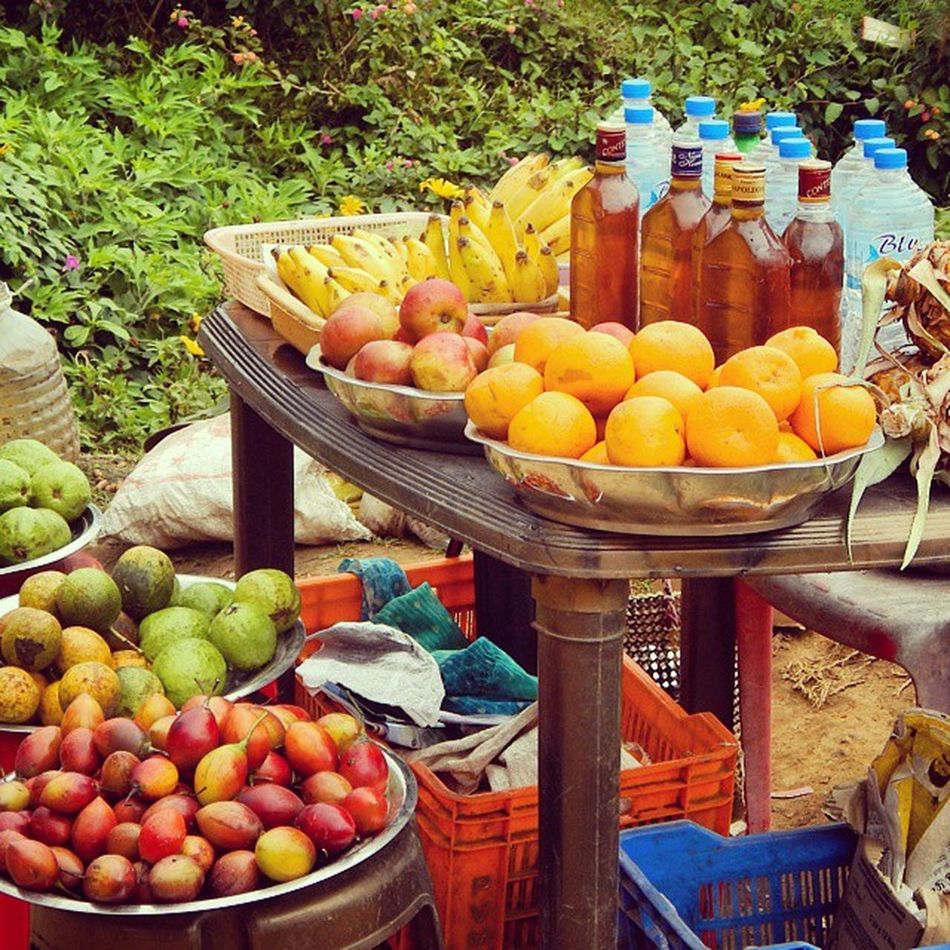 A roadside fruit stall at @munnar A Canonclick Trip Friends Fun Canon I20 Fruits Water Sqash Juice Orange Colorful Memory Insta Instagram Valenciafilter : Sreeni