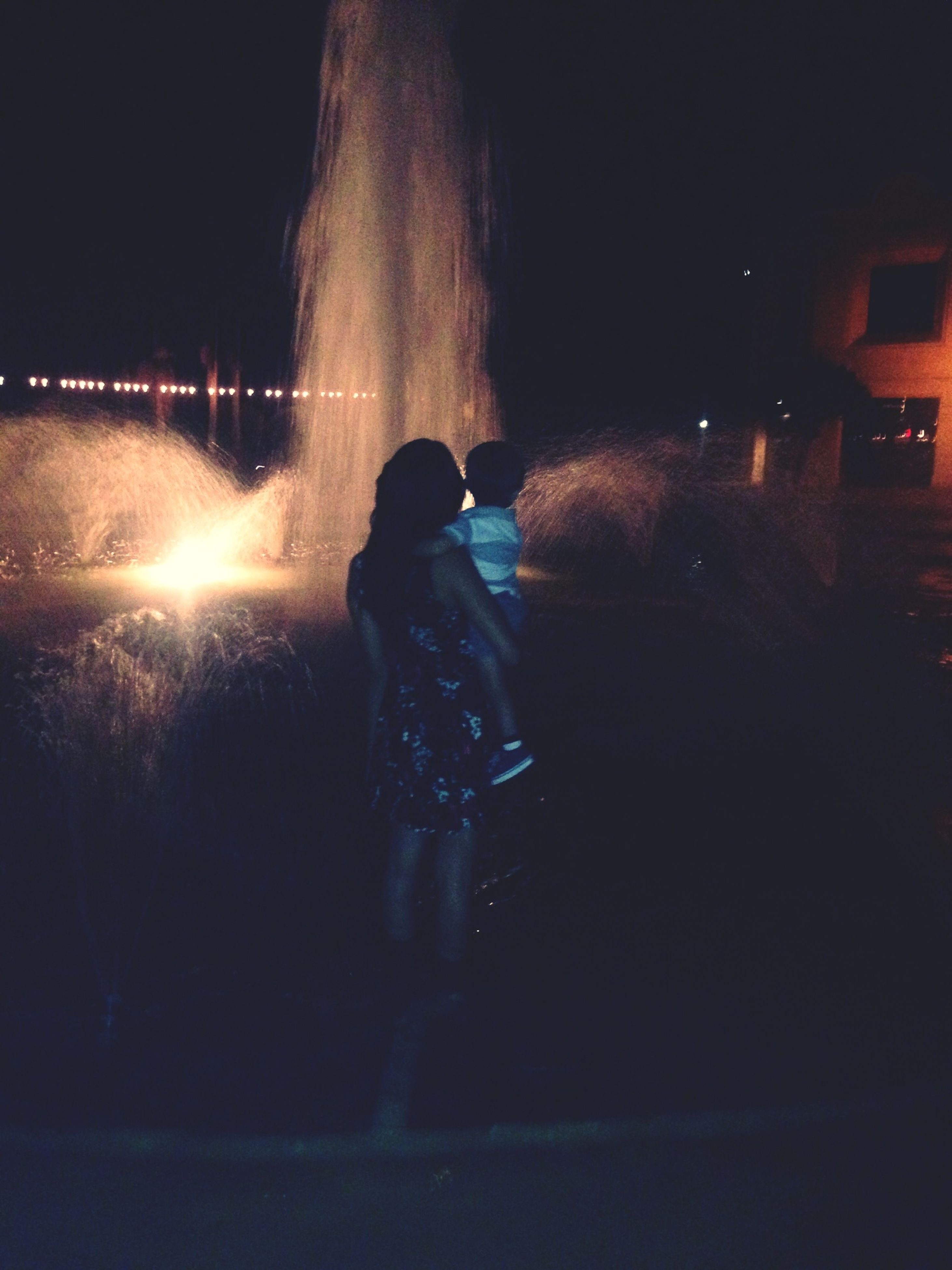 lifestyles, full length, leisure activity, rear view, standing, night, men, illuminated, casual clothing, silhouette, person, walking, water, outdoors, three quarter length, sunlight, built structure