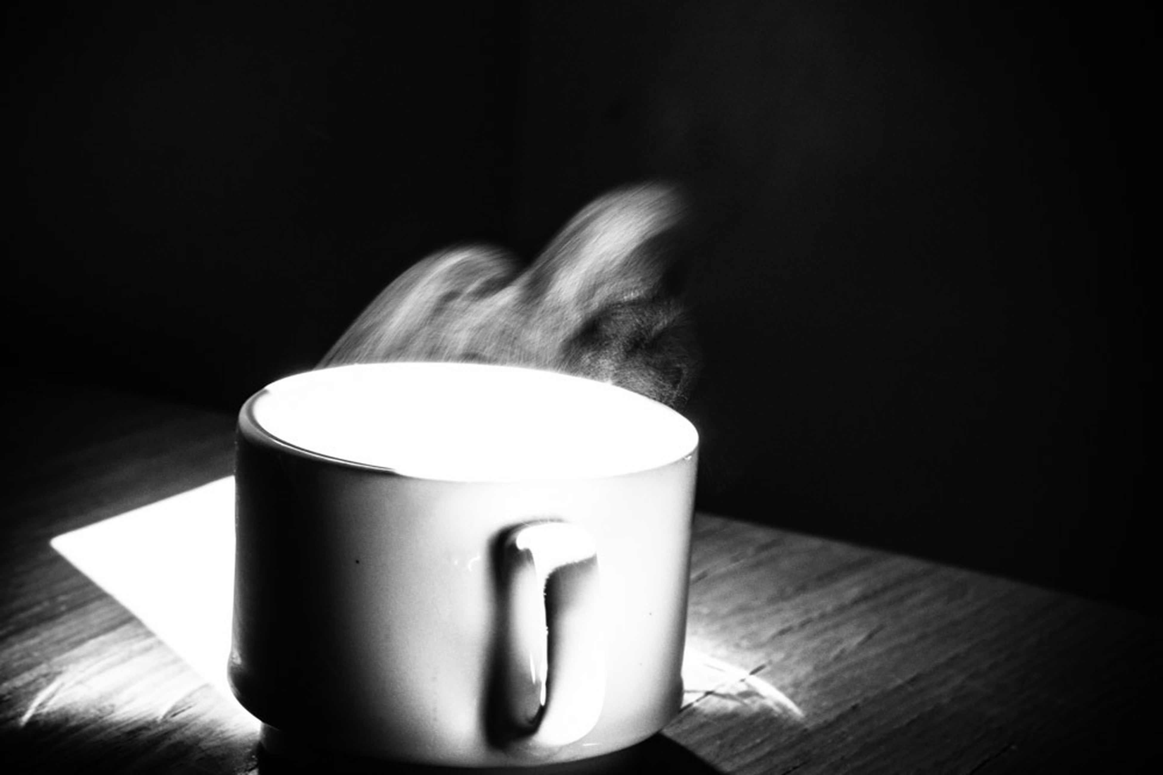 indoors, drink, food and drink, coffee cup, table, refreshment, still life, coffee - drink, close-up, coffee, freshness, cup, saucer, beverage, no people, frothy drink, candle, black background, heat - temperature, focus on foreground