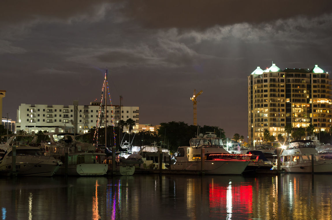 Moon Rays Over Sarasota Architecture Boats Built Structure City City Life Cityscape Community Crane Development Florida Human Settlement Illuminated Marina Moon Rays Nautical Vessel Night Night Lights Night Photography Outdoors Reflection Reflections Sky And Clouds Water Waterfront