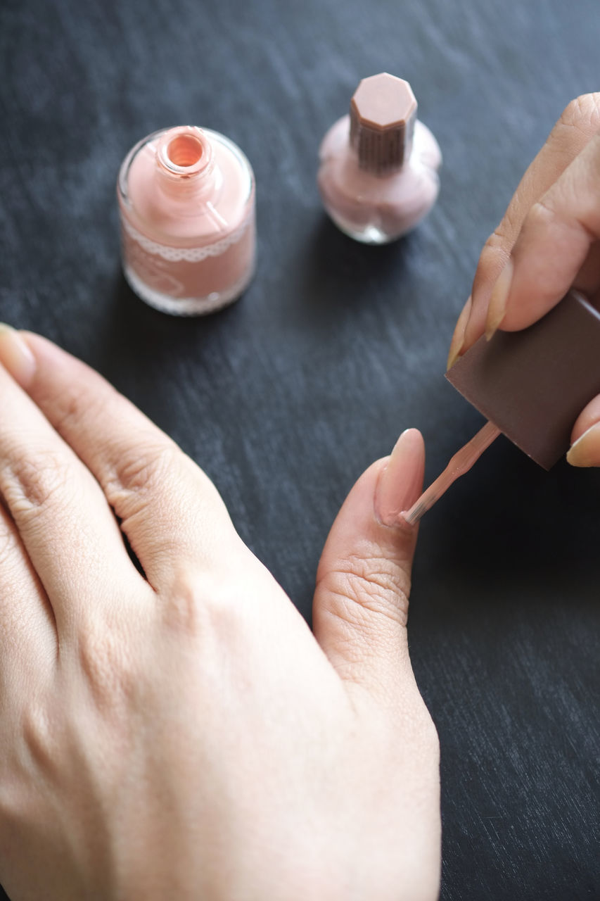 human hand, human body part, human finger, high angle view, real people, table, indoors, close-up, holding, sweet food, nail polish, food, one person, ready-to-eat, day