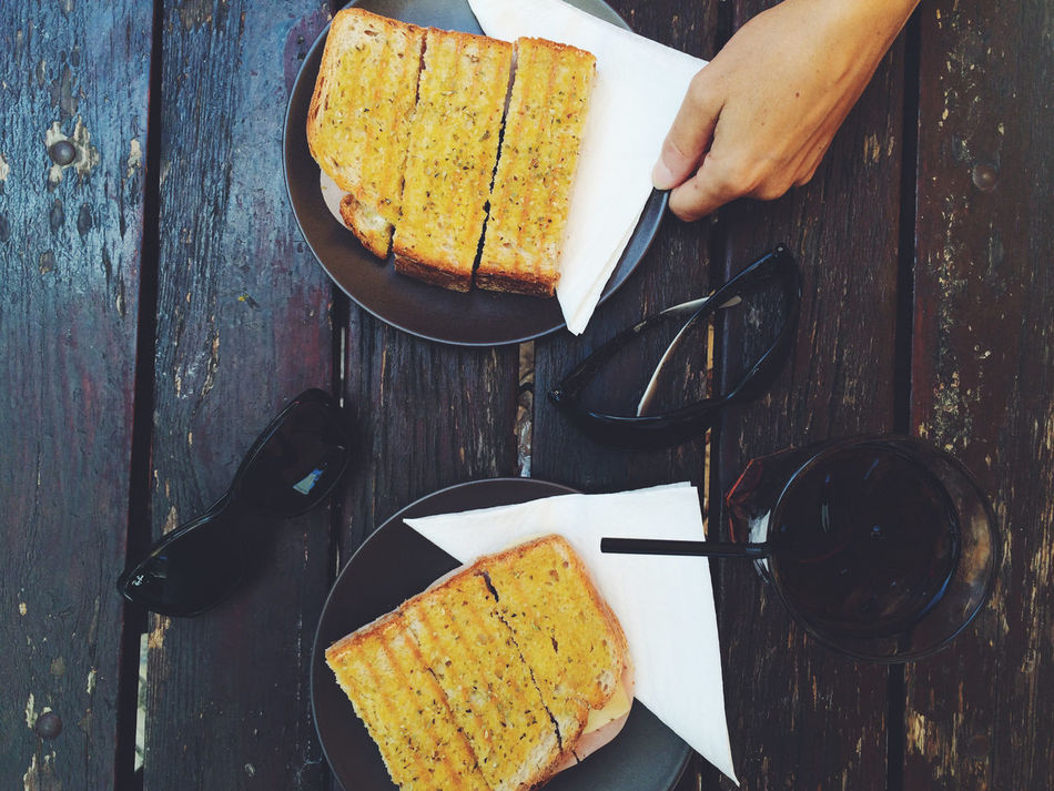 Bread Close-up Day Eating Food Food And Drink Freshness Human Body Part Human Hand One Person People Plate Ready-to-eat Table Wood - Material