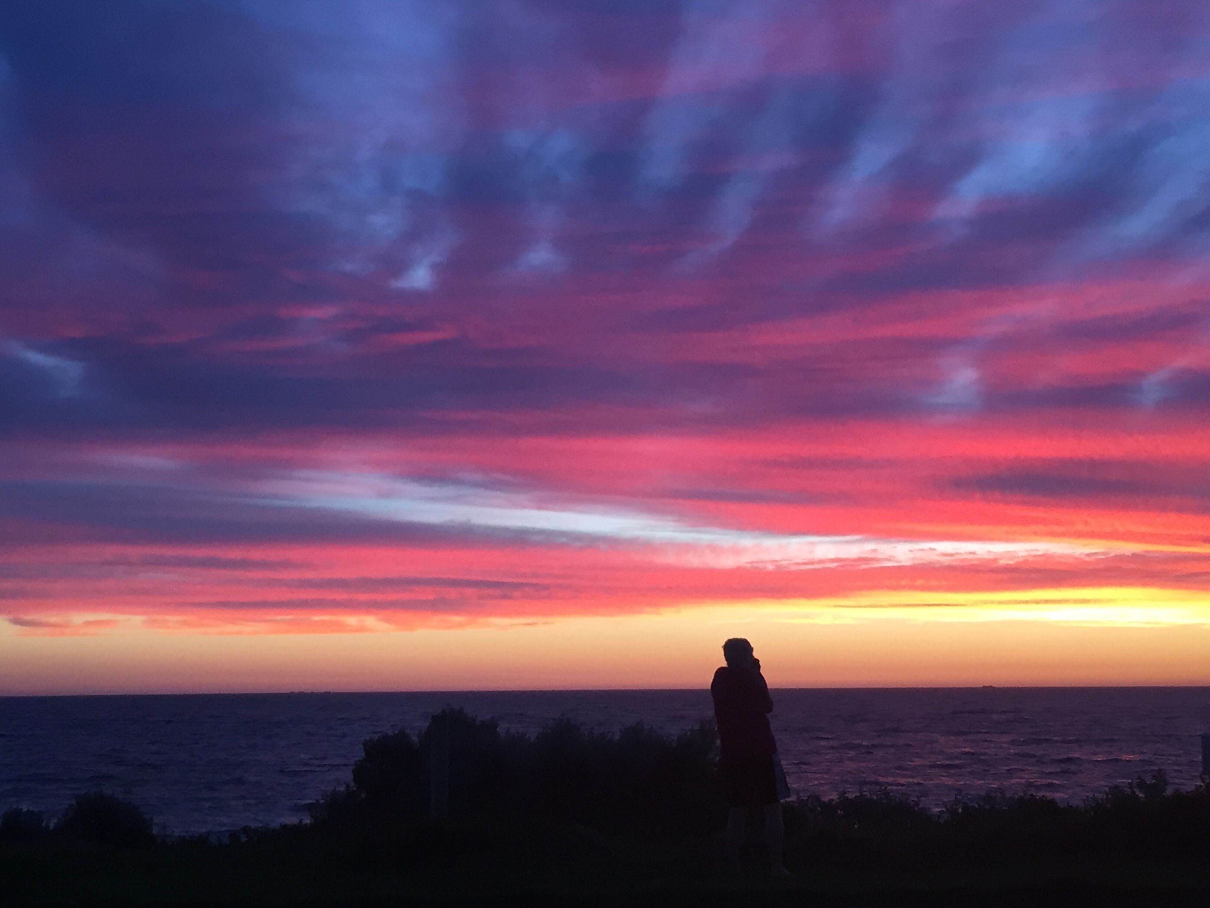 sea, sunset, horizon over water, sky, scenics, water, beauty in nature, tranquil scene, silhouette, tranquility, orange color, idyllic, nature, beach, cloud - sky, shore, dramatic sky, standing, cloud, rock - object