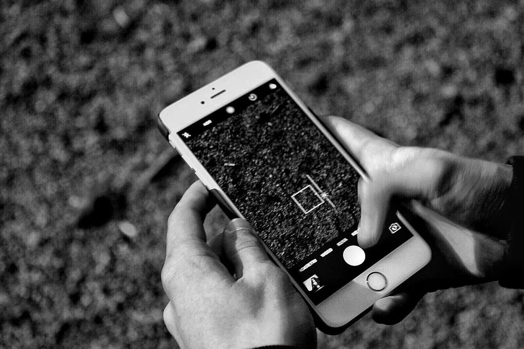 Just a phone Holding Smart Phone Mobile Phone Communication Technology Wireless Technology Human Hand Touch Screen Human Body Part Device Screen Capture Photograph Photographing Blackandwhite Outdoors No People Canonphotography Canon500d