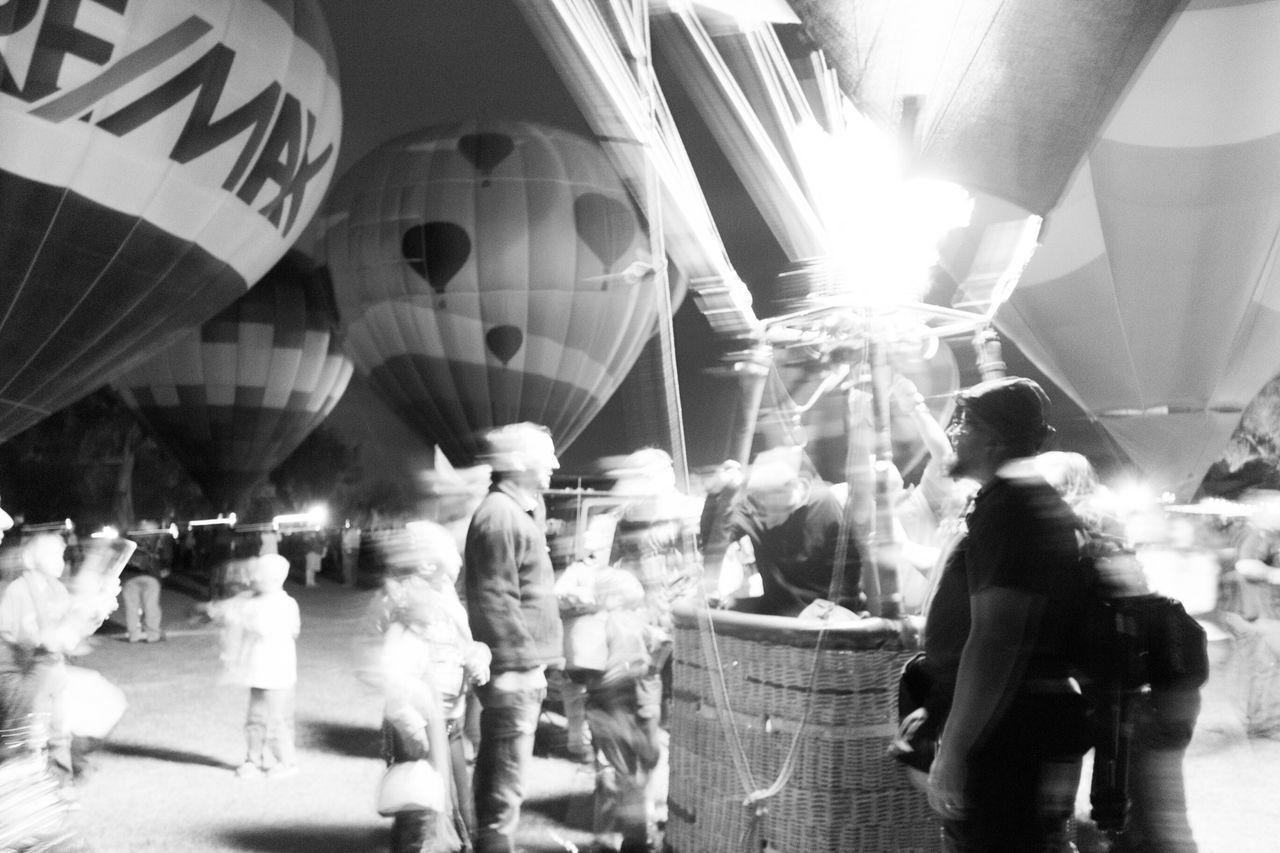 Bodies in motion. Tucson Az Liftoff Preparation  Capture The Moment Living And Learning Helping Hand Beanie Winterfest Outdoor Photography Thephotographer Upupandaway Adventures Nightphotography Eye4photography  Arizona Tubac Photography Blackandwhite Photography Myperspective Artistsmind My Husband Hotairballoon My Best Photo 2015 B&w Street Photography Fine Art Photography
