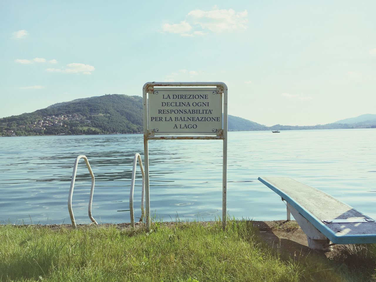 Attenzioni. Text Western Script Communication Water Sea Sky Day Mountain No People Tranquility Outdoors Nature Guidance Signboard Cloud - Sky Scenics Welcome Sign Grass Beauty In Nature Warning Sign Lake Italian