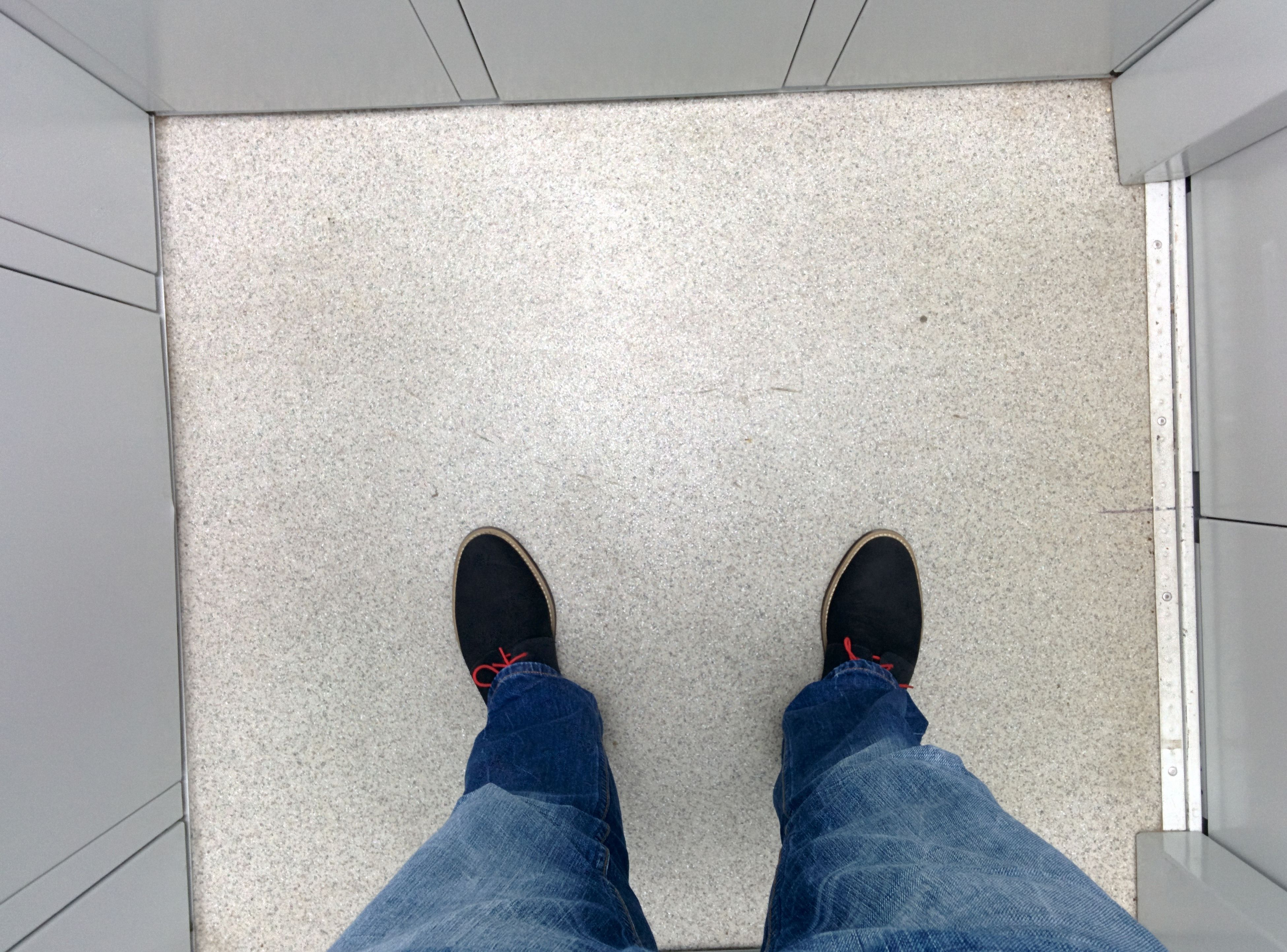 low section, person, shoe, lifestyles, personal perspective, men, human foot, footwear, high angle view, standing, leisure activity, jeans, part of, unrecognizable person, casual clothing, one man only, indoors