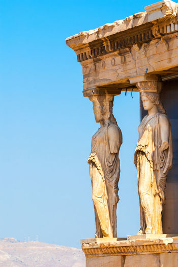Detail of caryatids statues on the Parthenon on Acropolis Hill, Athens, Greece Acropolis, Athens Athens, Greece Caryatid Caryatids Of The Acropolis Classic Parthenon Acropolis Greece Tourist Attraction  Ancient Civilization Architecture Art Art And Craft Athens Day Famous Place Greece History Landmark Landmark Building Monument Old Ruin Sculpture Statue Temple Tourist Destination Travel Destinations