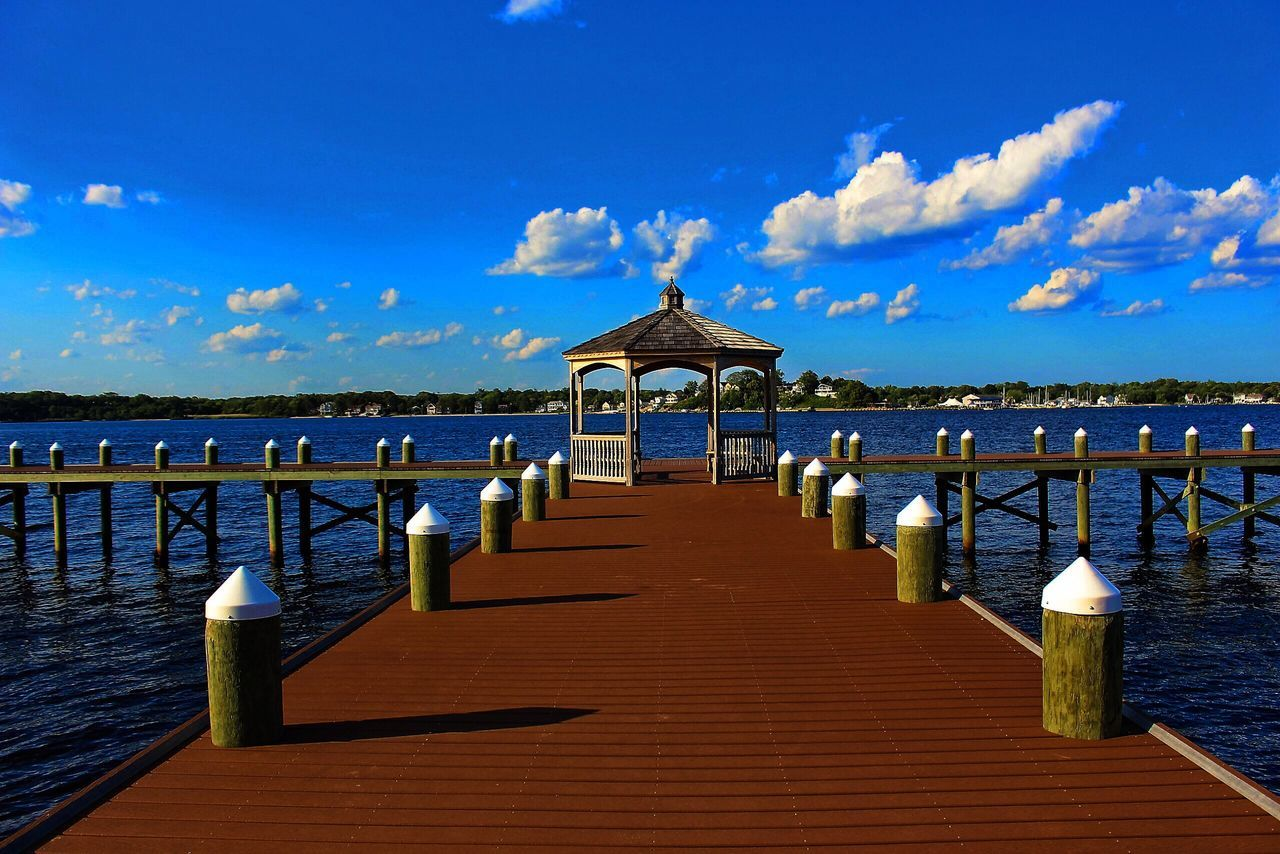 sky, sea, water, pier, cloud - sky, tranquility, nature, jetty, scenics, tranquil scene, day, wood - material, blue, outdoors, built structure, beauty in nature, horizon over water, beach, sunlight, architecture, travel destinations, vacations, no people, nautical vessel