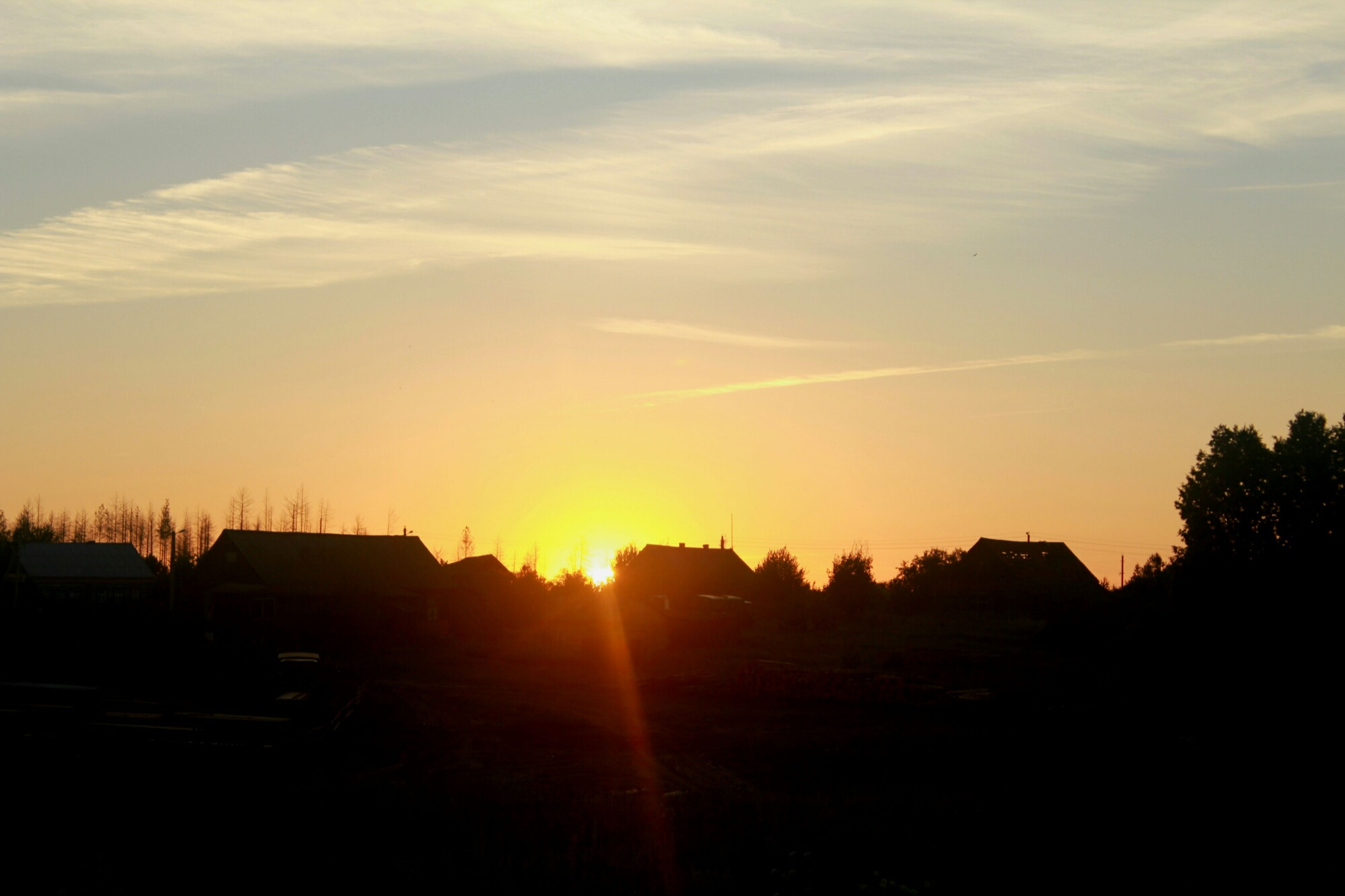 sunset, sun, silhouette, building exterior, architecture, built structure, sky, sunlight, sunbeam, tree, house, scenics, beauty in nature, orange color, nature, lens flare, cloud - sky, landscape, tranquil scene, tranquility