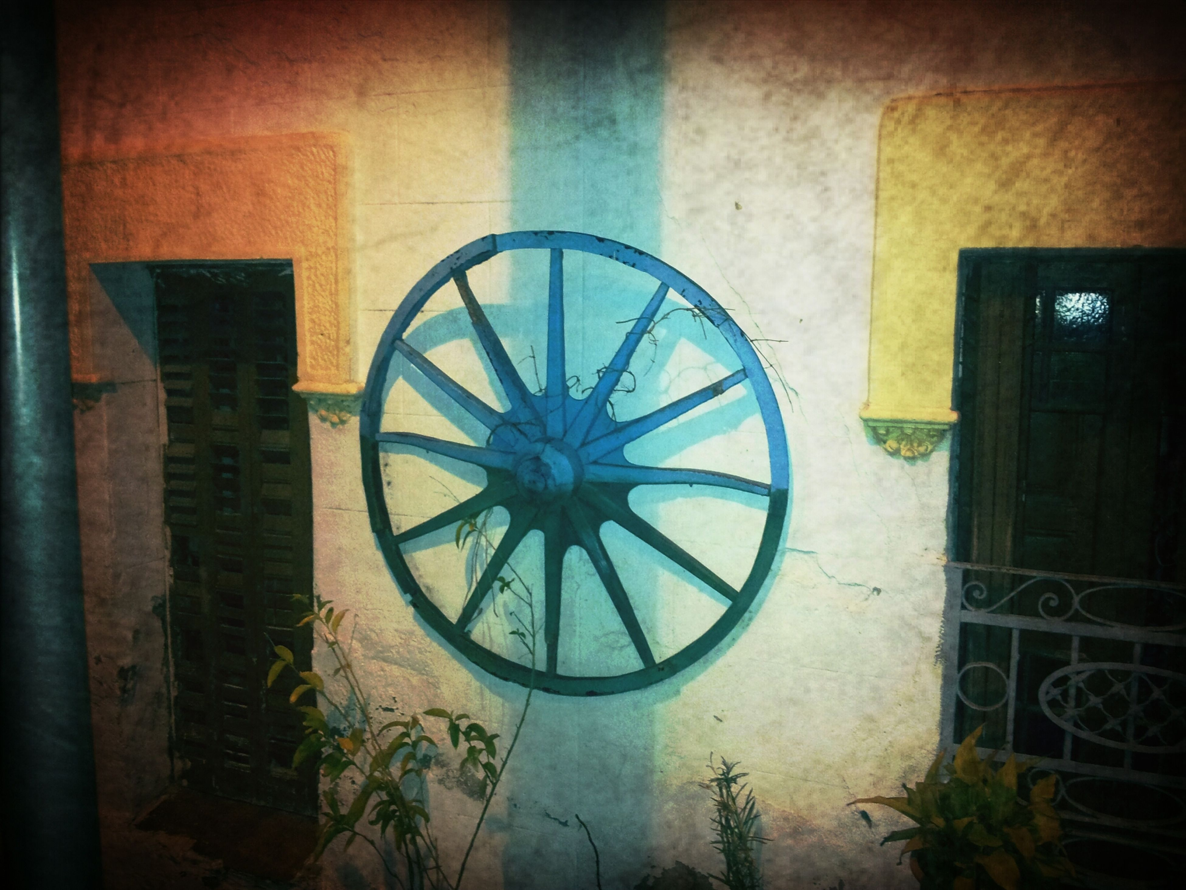 architecture, built structure, building exterior, wall - building feature, window, house, wall, circle, bicycle, indoors, no people, old, building, day, wheel, abandoned, geometric shape, residential structure, auto post production filter