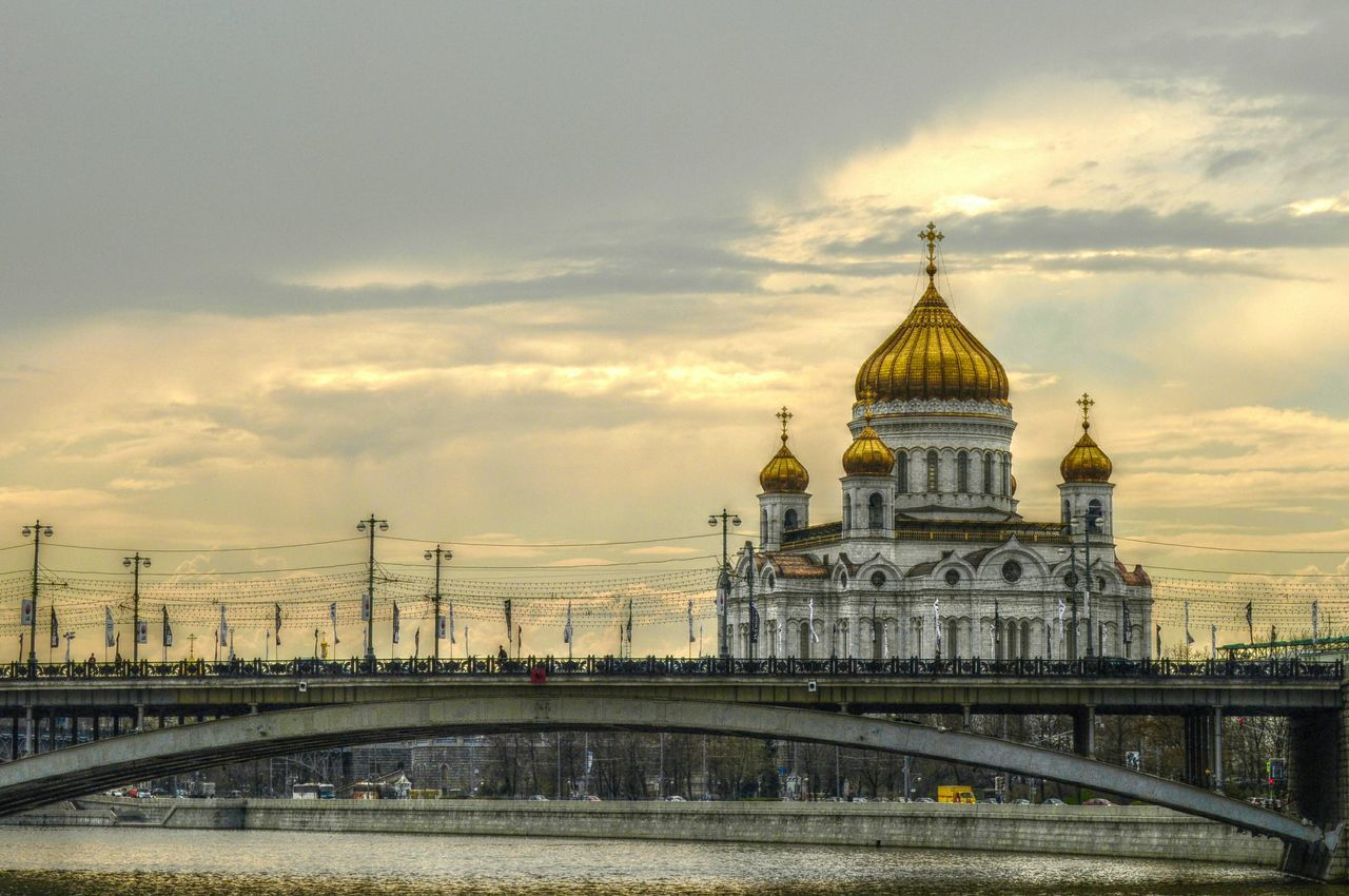 Arch Bridge And Church With Gold Domes At Dusk