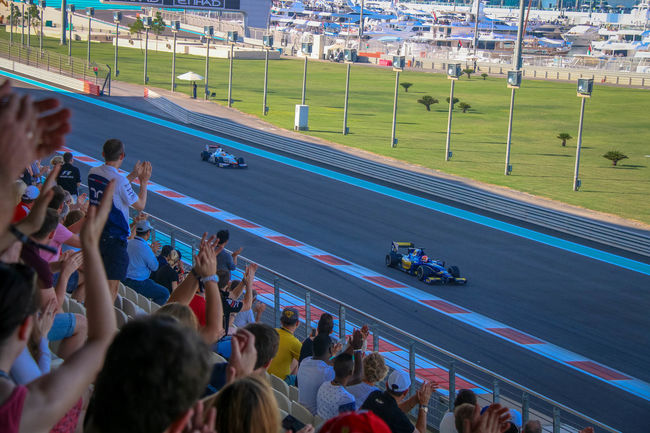 Formula 1 in Yas Marina Circuit Abu Dhabi Cars Etihad F1 Formulaone GrandPrix On The Move Racing Racing Car Simplyabudhabi Spectators United Arab Emirates YasMarinaCircuit Tourists The Tourist The Human Condition Feel The Journey