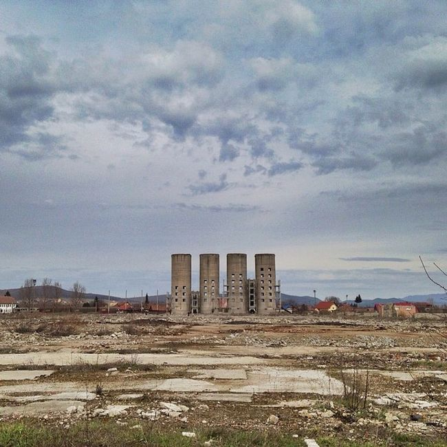 Right in the Middle . The old towers from a rundown City , Reghin . VividHDR IPhone5