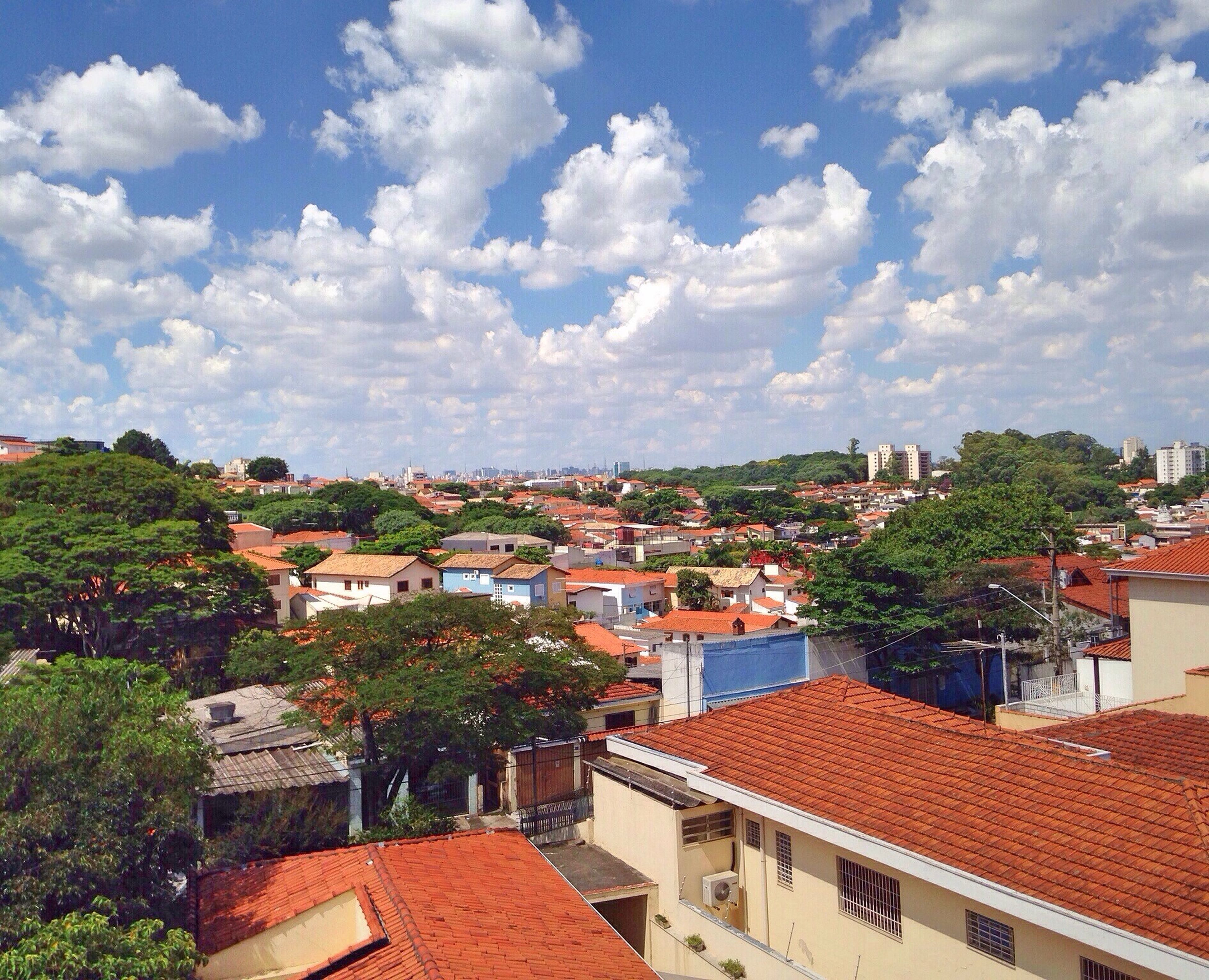 building exterior, architecture, built structure, sky, house, tree, residential structure, residential building, residential district, roof, city, cloud - sky, high angle view, town, crowded, townscape, cityscape, cloud, cloudy, day