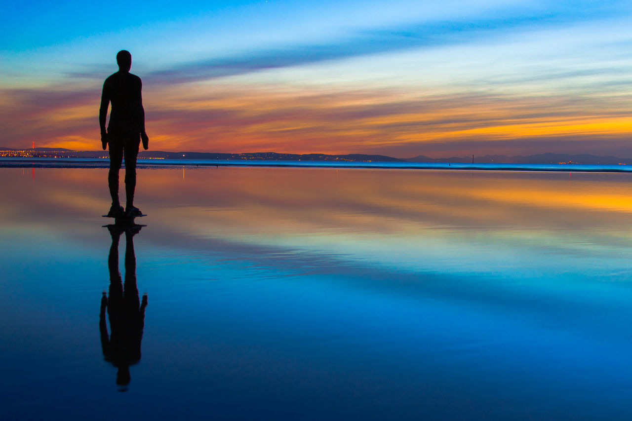 Another Place Another Place By Anthony Gormley Another Place On Crosby Beach Beauty In Nature Crosby Beach Long Exposure Nature One Person Outdoors People Scenics Sea Sky Sunset Tranquility Water
