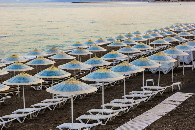 Absence Arrangement Beach Beach Umbrella Chair Day Empty Horizon Over Water In A Row Large Group Of Objects Off Season Parasol Repetition Sea Seat Shore Sky Spring Summer Sunlight Tranquil Scene Tranquility Umbrella Vacations Water Market Reviewers' Top Picks