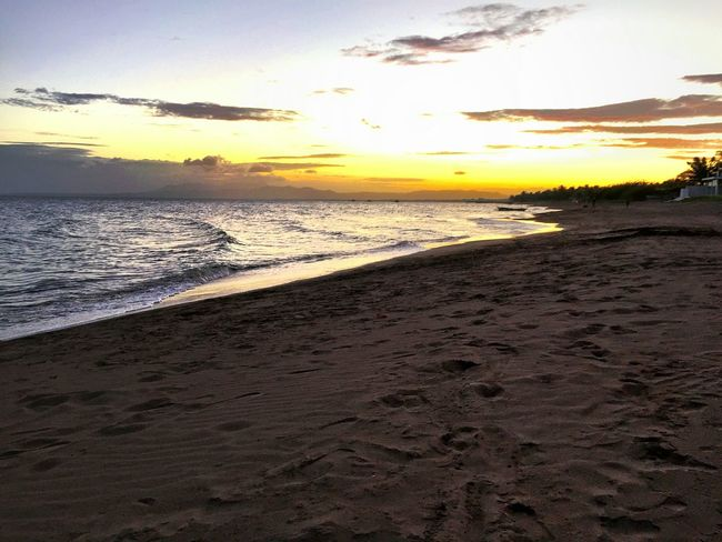 sunset view from a stretch of sand and sea that was virtually all ours || Sunset Clouds And Sky Sea And Sky Nature It's Always Summer In The Philippines Pilipinas