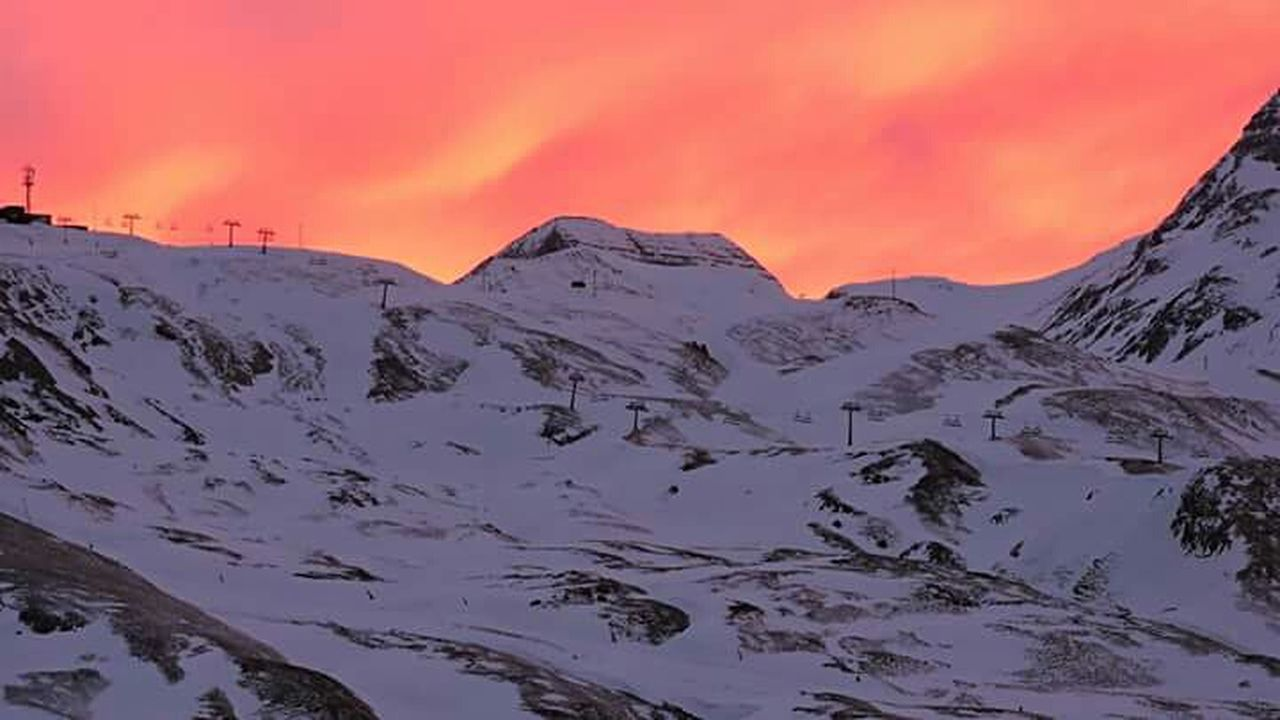 mountain, sunset, snow, landscape, dramatic sky, cold temperature, scenics, nature, beauty in nature, winter, outdoors, environment, mountain peak, no people, mountain range, cloud - sky, sky, snowcapped mountain, tranquility, travel destinations, day, dawn