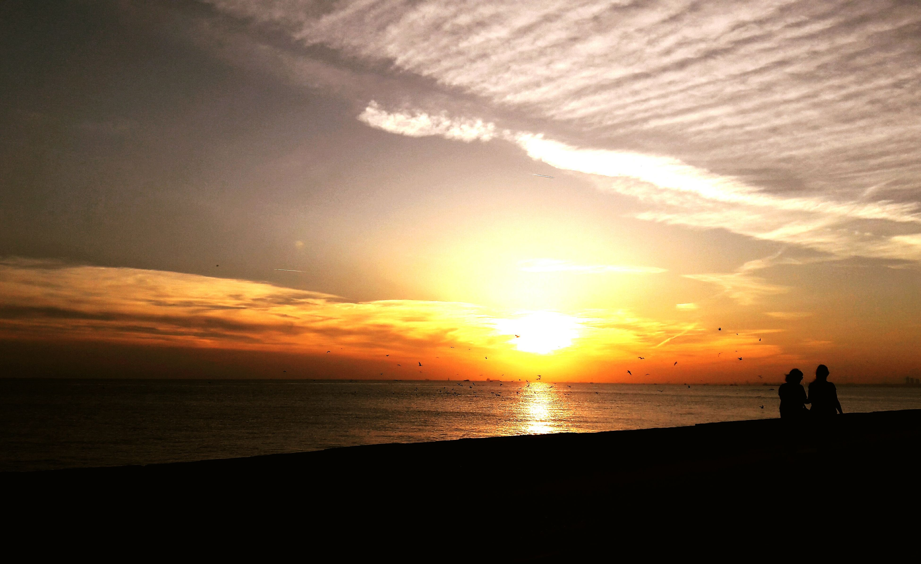 sunset, sea, water, horizon over water, silhouette, scenics, tranquil scene, beach, tranquility, sun, beauty in nature, idyllic, sky, nature, reflection, orange color, shore, cloud, calm, remote, majestic, outdoors, cloud - sky, ocean, vacations, moody sky, romantic sky, outline