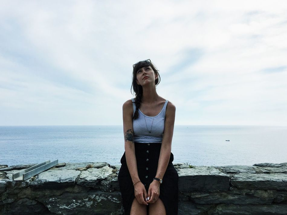 Sea Horizon Over Water One Person Real People Three Quarter Length Sky Young Adult Front View Looking At Camera Standing Portrait Young Women Water Lifestyles Leisure Activity Nature Day Beautiful Woman Beauty In Nature Smiling