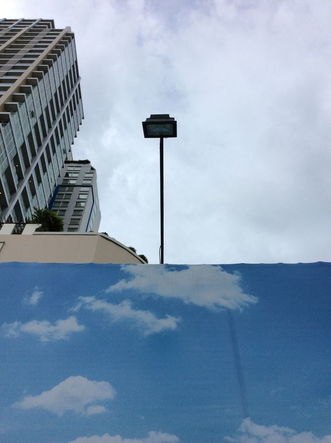 Bangkok Thailand. Sky Poster Overhead Lamp High Rise Buildings Apartment Blocks Blue Sky And Clouds