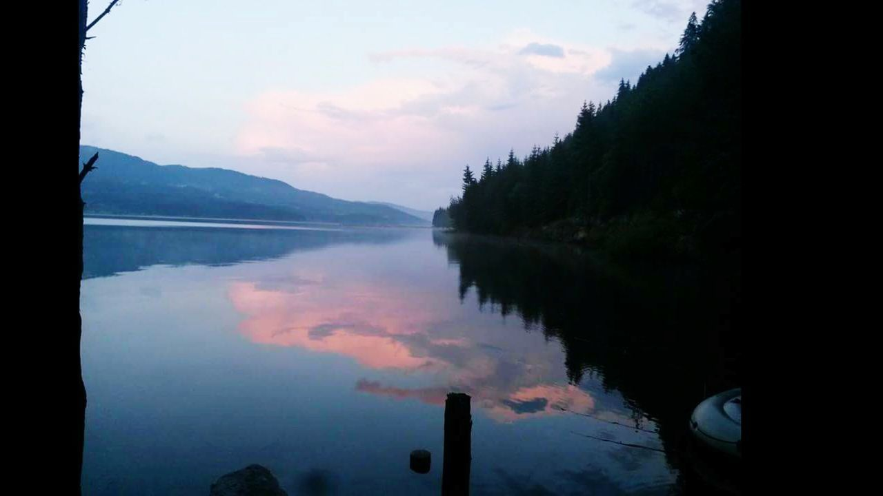 water, mountain, reflection, lake, sky, scenics, beauty in nature, no people, nature, outdoors, tranquil scene, tranquility, mountain range, day, tree, cloud - sky, close-up