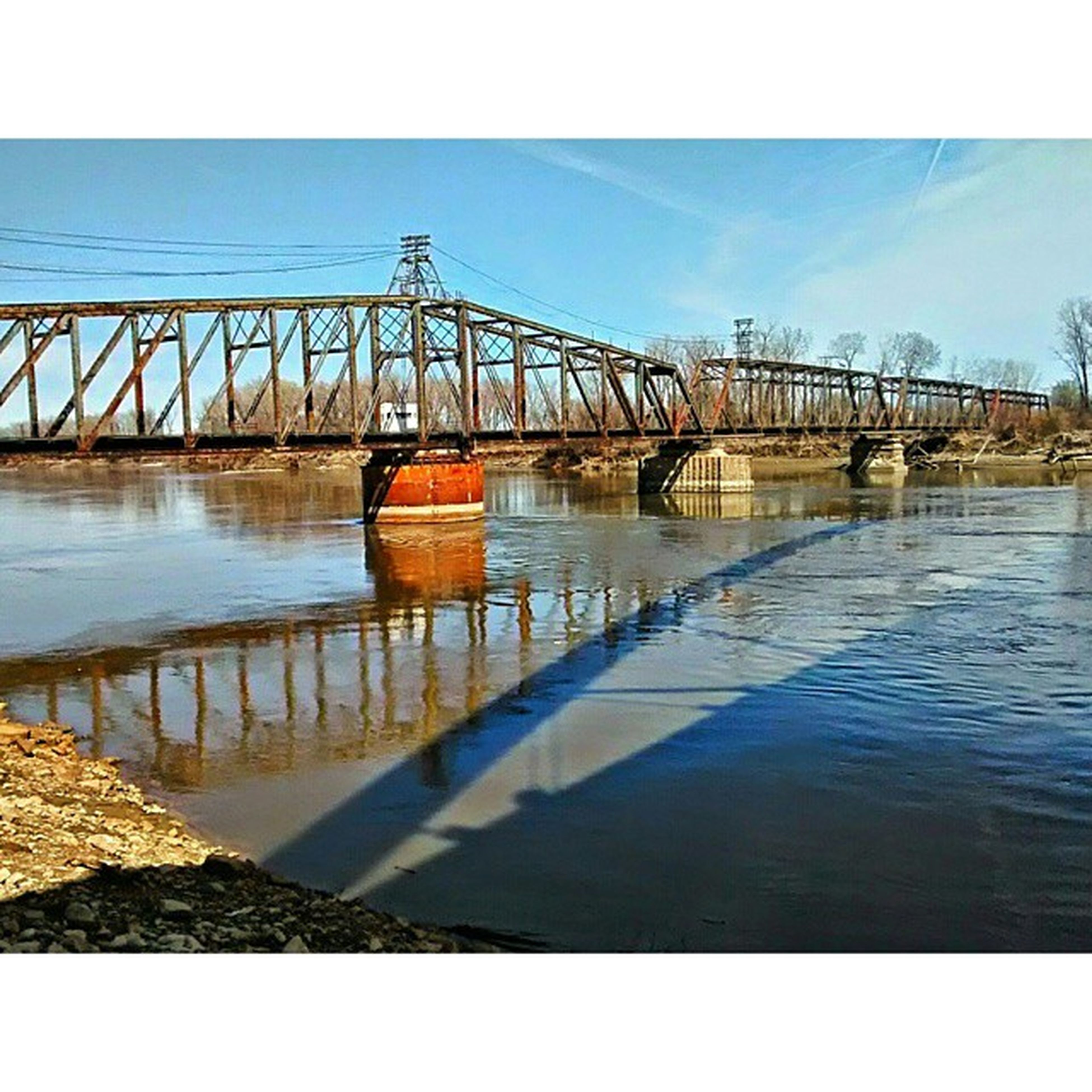 water, connection, bridge - man made structure, built structure, architecture, river, bridge, sky, engineering, railing, transportation, blue, long, waterfront, diminishing perspective, outdoors, clear sky, the way forward, transfer print, rippled
