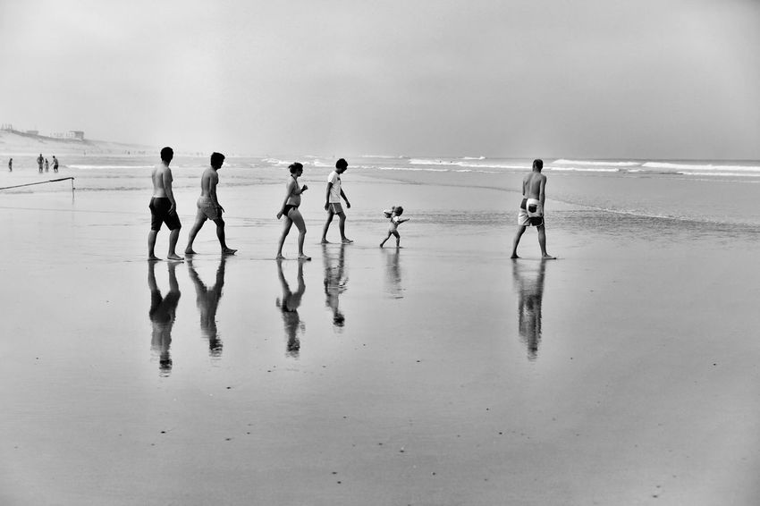 Group of people walking on the beach Outdoors Nature Sky Cloud - Sky Water Ocean Atlantic Ocean Horizon Over Water Teamwork Enjoy The New Normal Nature Togheterness Friends Family BYOPaper! Investing In Quality Of Life The Week On EyeEm