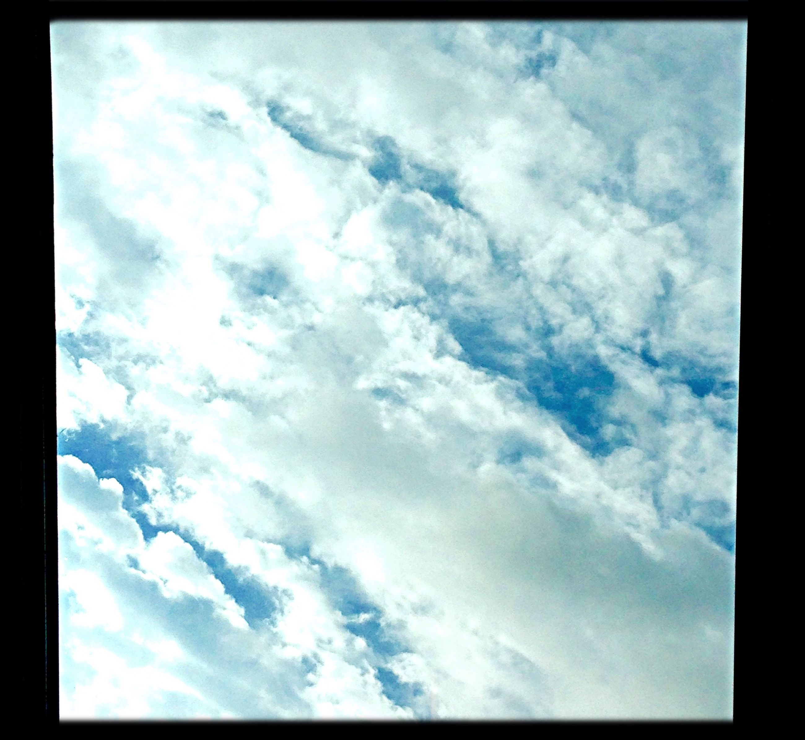 sky, transfer print, cloud - sky, low angle view, cloudy, auto post production filter, beauty in nature, tranquility, scenics, cloud, nature, tranquil scene, cloudscape, weather, sky only, overcast, idyllic, backgrounds, outdoors, day