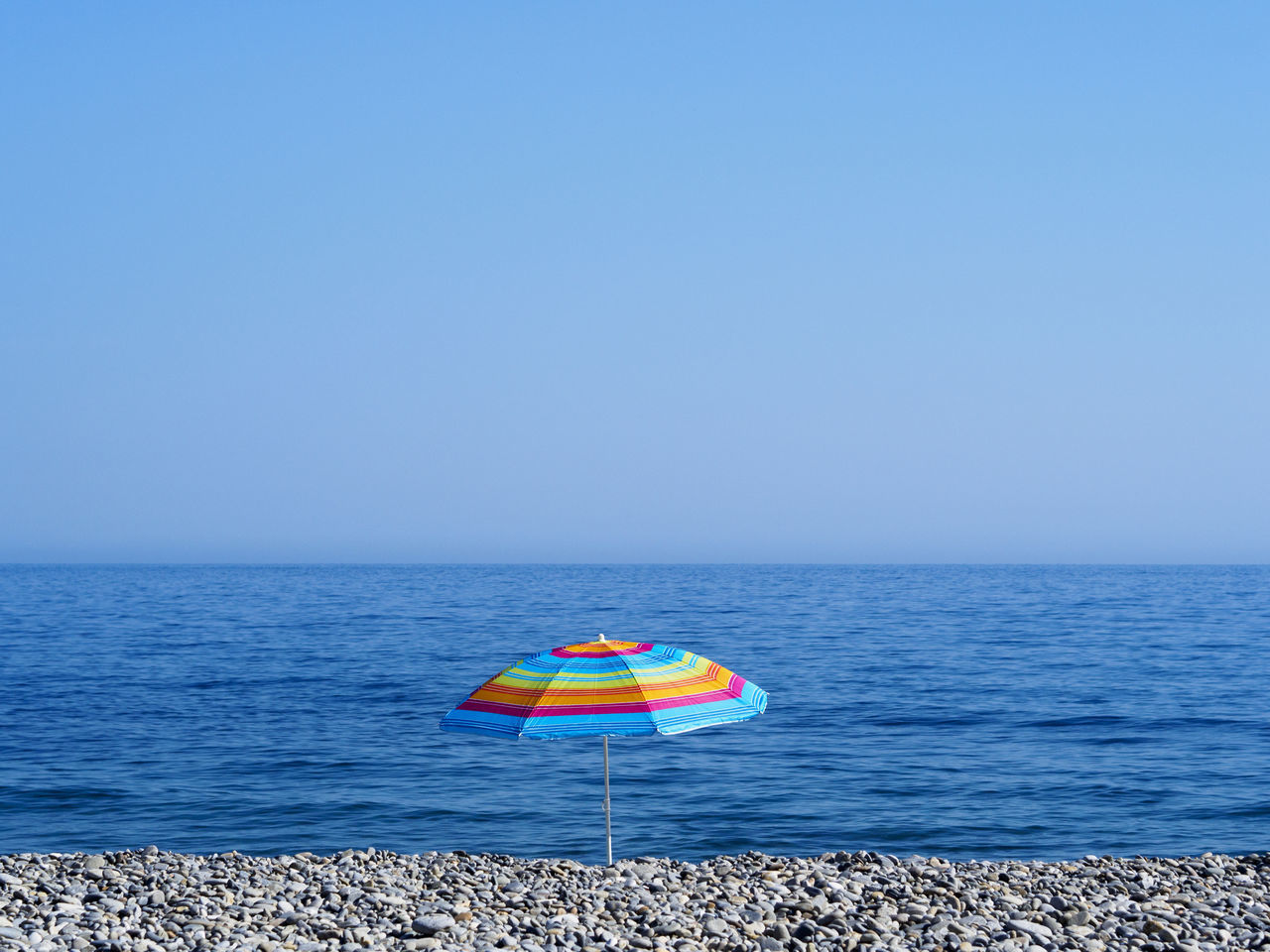 Sougia beach on the south side of Crete Beach Blue Clear Sky Holiday Horizon Over Water Minimalism Multi Colored No People Pebble Beach Relaxation Sea Sky Summer Tranquil Scene Tranquility Umbrella Vacations Water