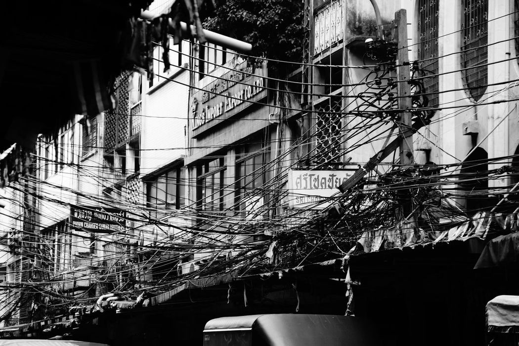 All local Electricians in Thailand must be genius! Architecture Bangkok Black & White Building Exterior Built Structure Cable Cables And Knots Chaos Day EyeEm Best Shots Growth Hanging House Lighting Equipment Low Angle View Railing Residential Structure Spotted In Thailand Wired Wired Art Wires Showcase April Telling Stories Differently Monochrome Photography Neighborhood Map