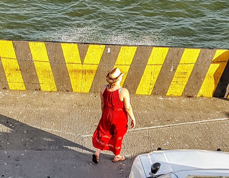 Red Dress Cowgirl On Texas Ferry High Angle View One Person Only Women Water Adult Red Women Lifestyles Outdoors Cowgirl Cowgirl Up Ferry Ferry Boat Texas Texas Made Paint The Town Yellow