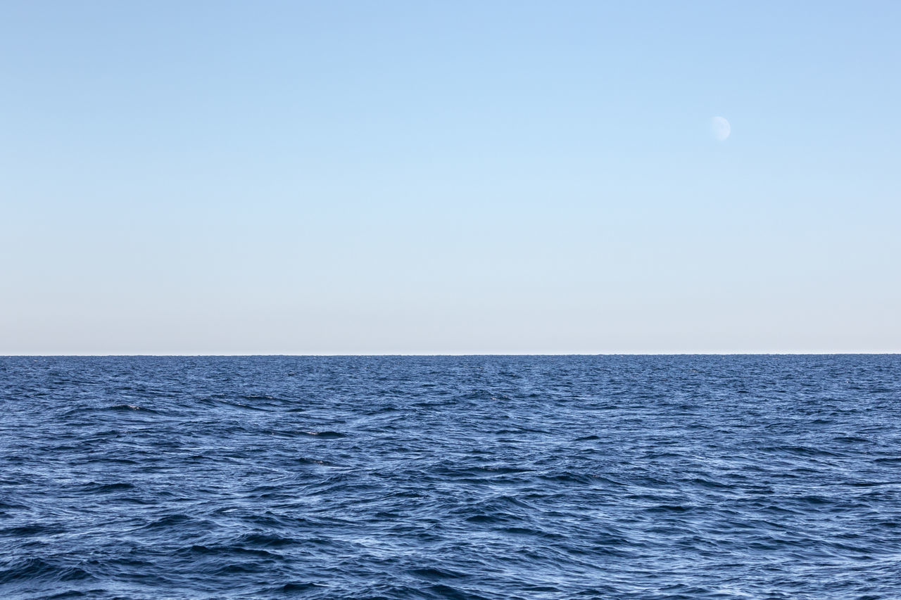 Waxing moon over open sea Beauty In Nature Blue Clear Sky Copy Space Day Freedom Horizon Over Water Infinity Landscape Moon Nature No People Norwegian Sea Outdoors Rippled Sailing Scenics Sea Seascape Sky Tranquil Scene Tranquility Water Waterfront Waxing Moon