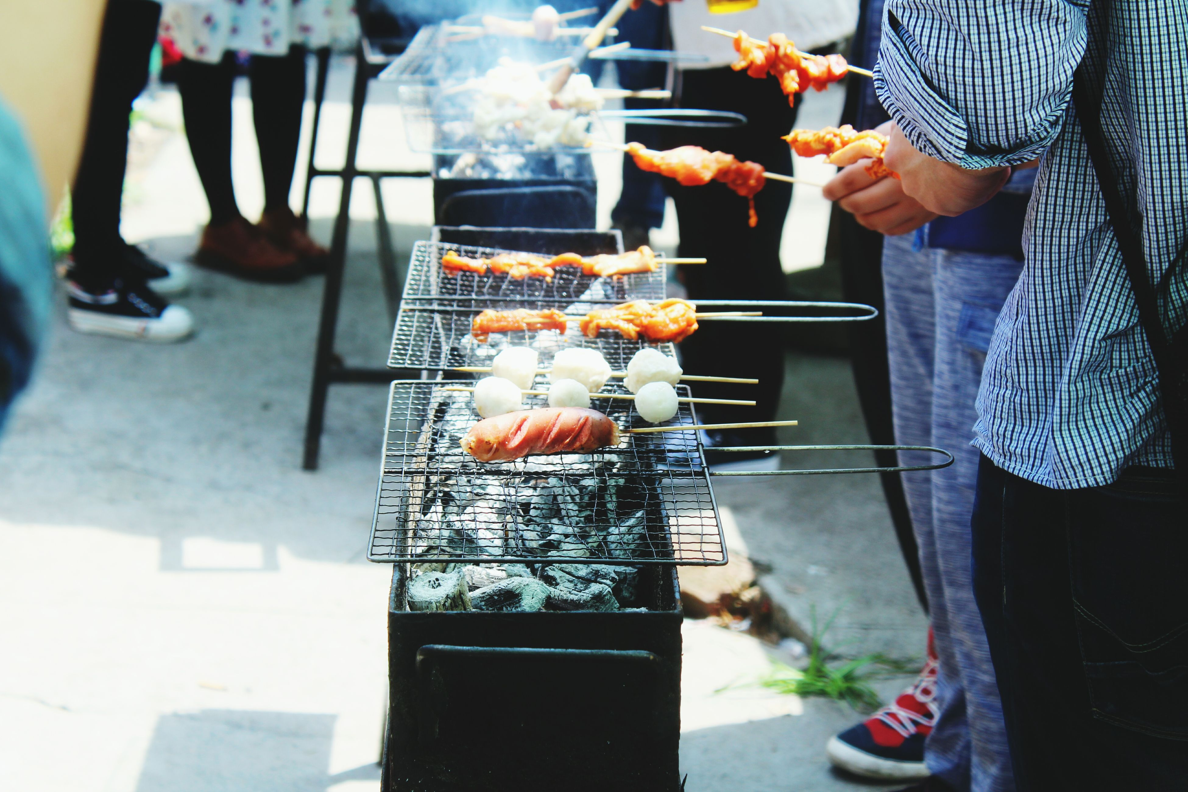 food and drink, food, men, freshness, lifestyles, holding, incidental people, indoors, person, preparation, leisure activity, barbecue grill, market stall, occupation, market, healthy eating
