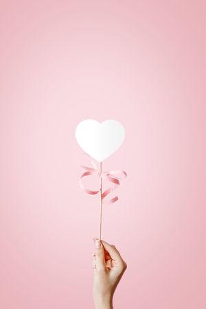 Hand holding white heart on sticks. Love and Valentine's day concept Concept Female Heart Heart Shape Love Love ♥ Paper Paper Heart Romance Symbol Valentine's Day  Velentine Woman