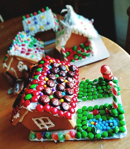 Making gingerbread houses for Christmas with assorted candies Christmas Gingerbread House Candies Sweet Activities Dessert Indulgence Food Table Celebration Close-up