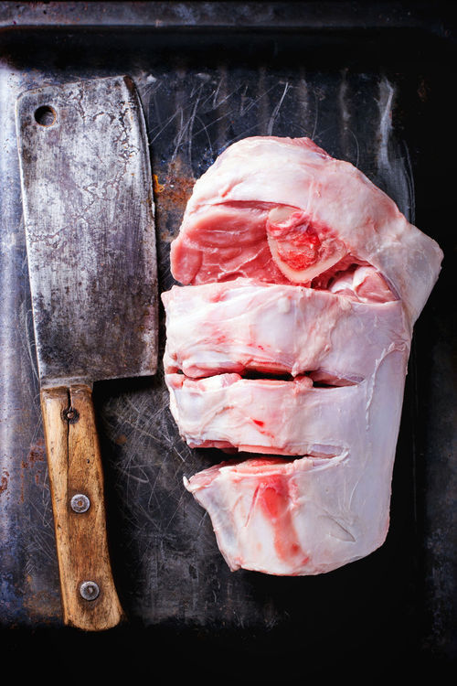 Raw cuting veal shank ossobuco with old backsword over black metal background. Top view. Beef Beef Black Butcher Cleaver Butchery Dark Photography Food Food Photography Fresh Meat Metal Background Ossobuco Overhead Raw Food Red Meat Shank Top View Of Food Uncooked Food Veal
