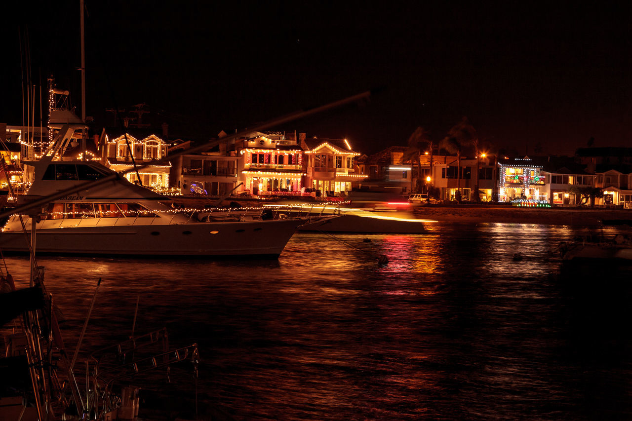 Newport Beach, CA, USA -December 16, 2016: Colorful holiday lights on sailboats and ships in the Balboa Harbor for the Newport Beach Christmas Boat Parade. Editorial use only. Balboa Island Boat Boat Dock Christmas Christmas Decoration Christmas Lights Decoration Festival Holiday Newport Beach Parade Sailboat Sailing