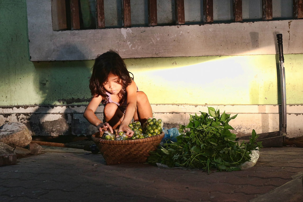 It was the right light from my car's headlight that made this photo a sentiment to my voice. The light cleared the child's face that shows how the street of Vigan City works at night. Childlabor Children Lost Night Shadow Shadows & Lights Street Streetphotography Vendor Working Working Hands