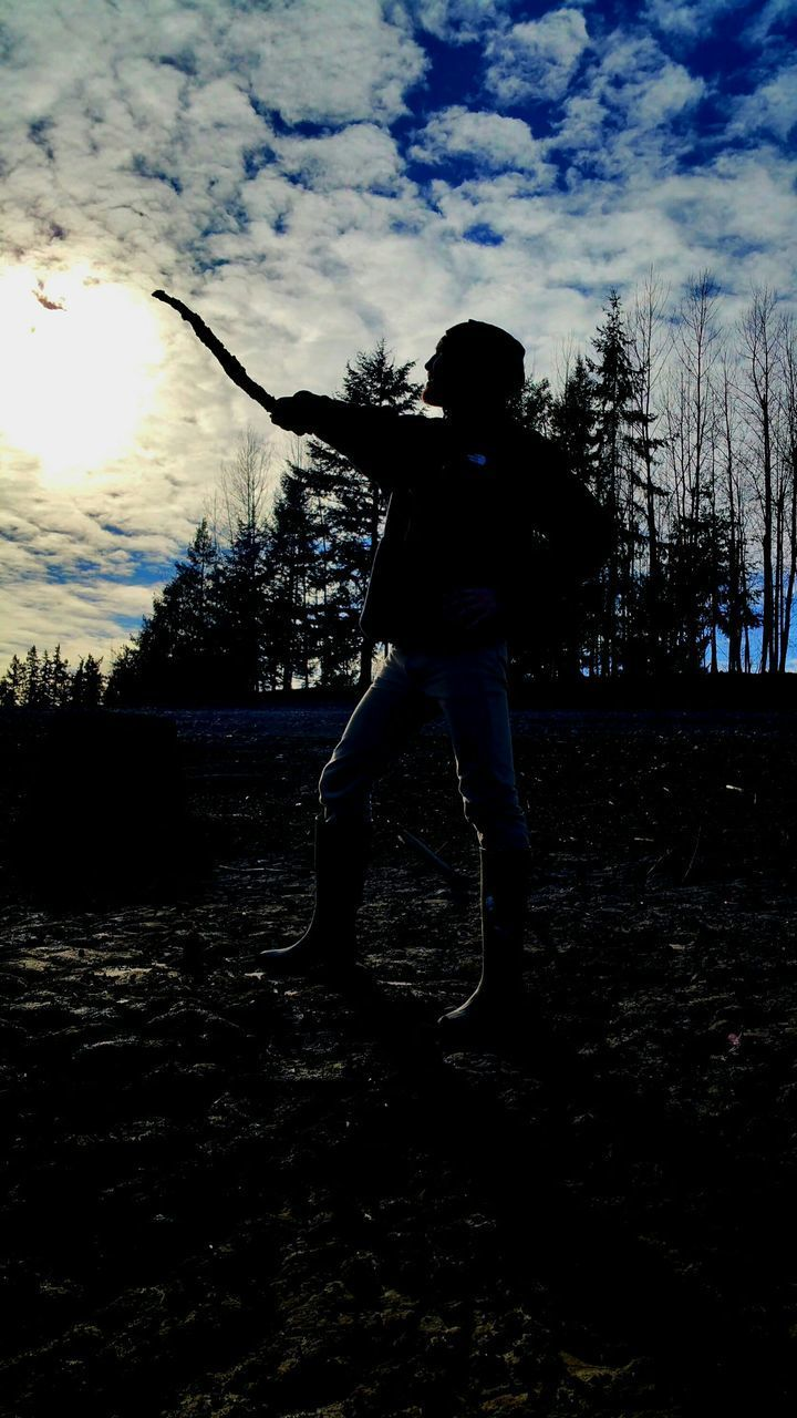 one person, full length, tree, real people, standing, silhouette, sky, rear view, leisure activity, men, motion, lifestyles, outdoors, childhood, sunset, day, nature, adult, people