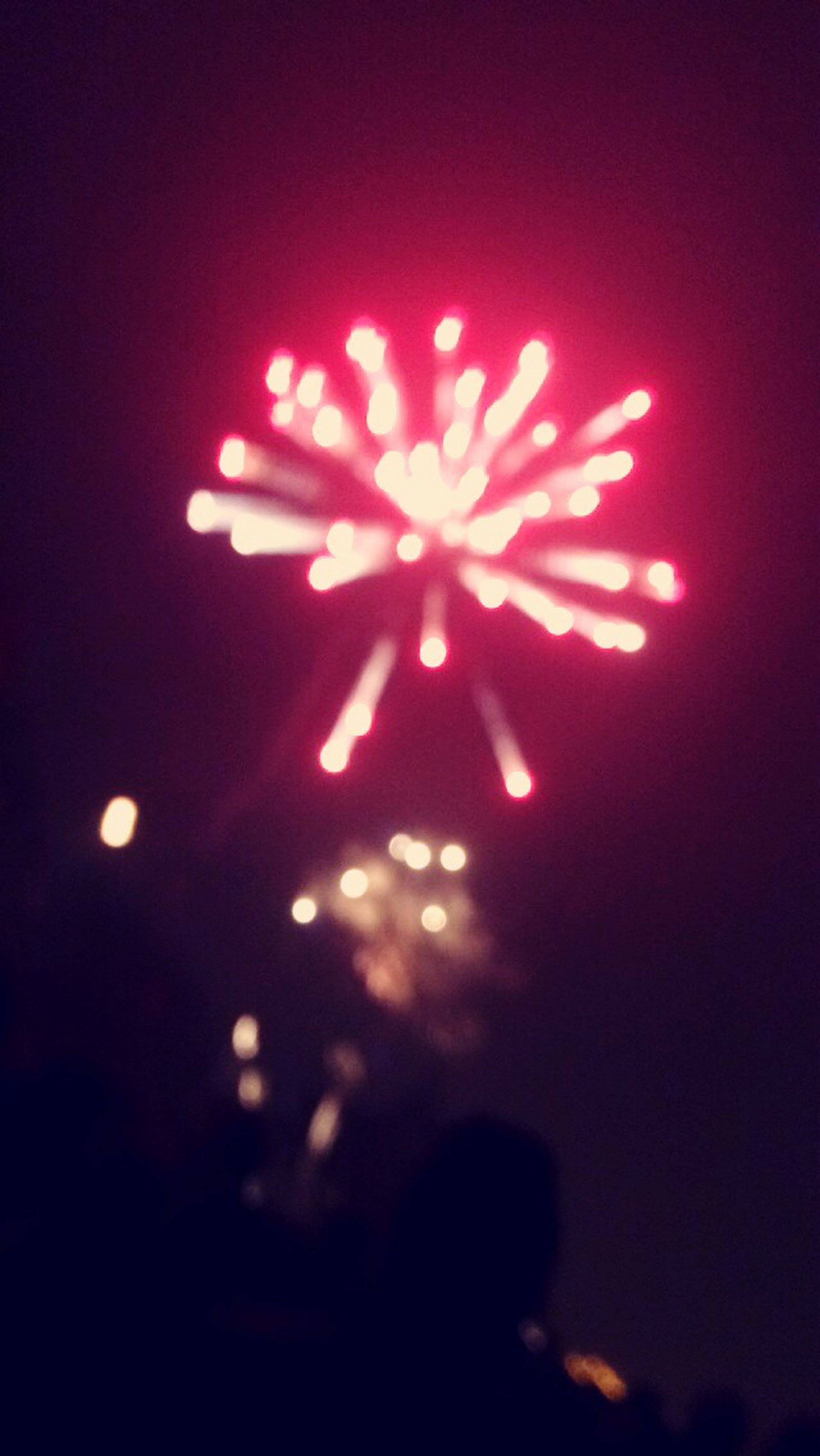 illuminated, night, red, celebration, glowing, event, light - natural phenomenon, indoors, low angle view, light, arts culture and entertainment, orange color, dark, lighting equipment, celebration event, firework display, sky, exploding