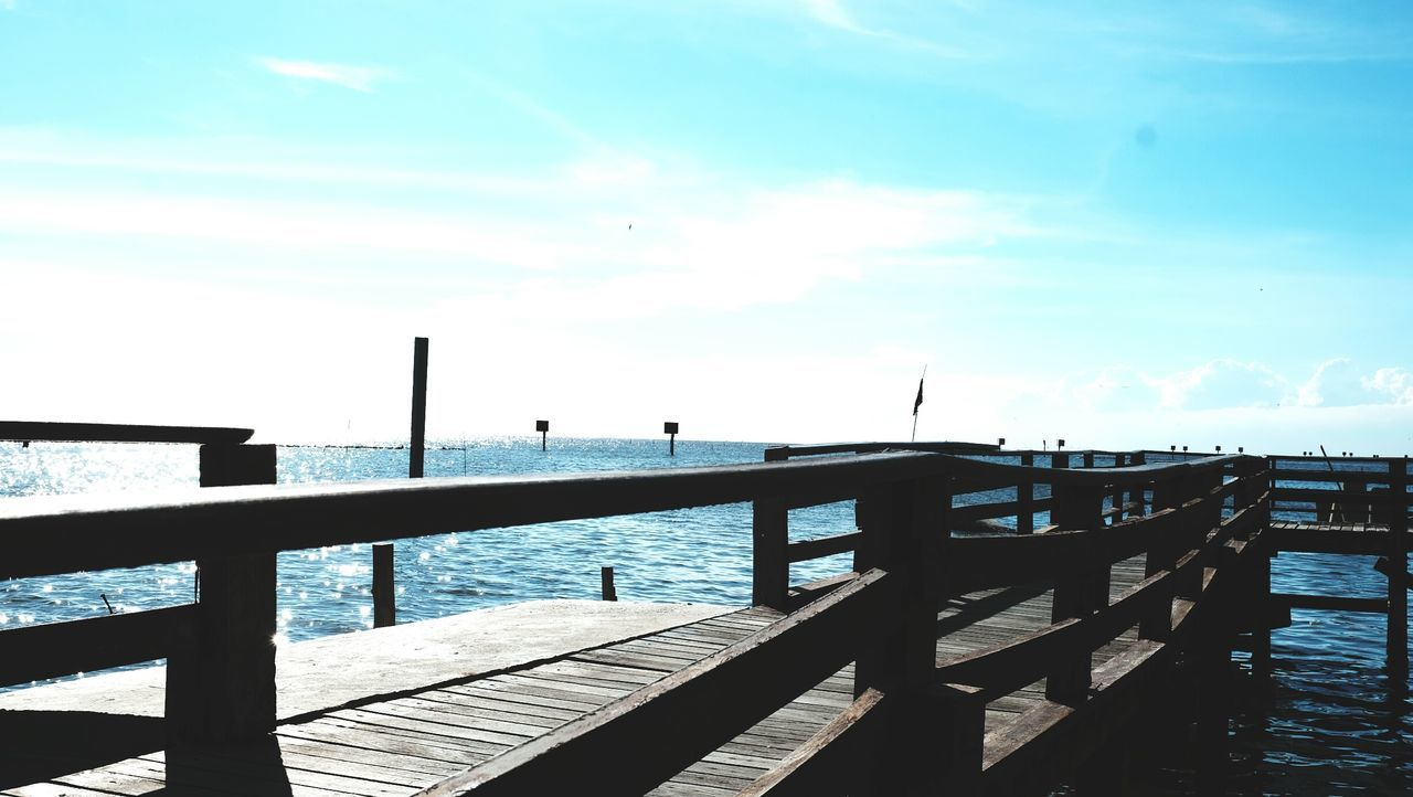 water, pier, sea, wood - material, beauty in nature, scenics, tranquil scene, tranquility, jetty, nature, railing, sky, day, outdoors, cloud - sky, no people, horizon over water, wood paneling